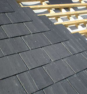 Part way through a slate roof in Reading